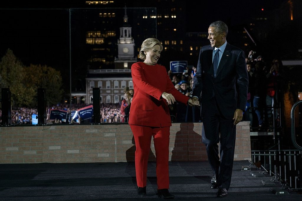 Hillary Clinton (L), 2016 Democratic presidential nominee is welcomed by US President Barack Obama during a rally on the Independence Mall in Philadelphia, Pennsylvania,on November 07, 2016 About 40,000 people flooded Independence Mall in Philadelphia for Hillary Clinton's rally with her husband Bill, President Barack Obama and his wife Michelle at her side, a campaign aide said. The attendance set a new record for Clinton, with the previous high point a rally in Ohio that drew 18,500 people, a campaign aide told reporters traveling with the candidate.  / AFP / Brendan Smialowski        (Photo credit should read BRENDAN SMIALOWSKI/AFP/Getty Images)